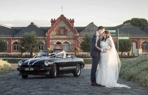 Bride and Groom together in front of Chateau Tanunda