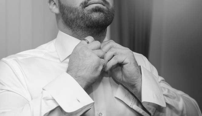 Putting on shirt
