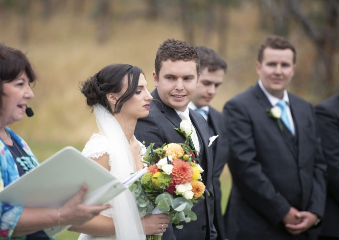 Groom glancing sideways