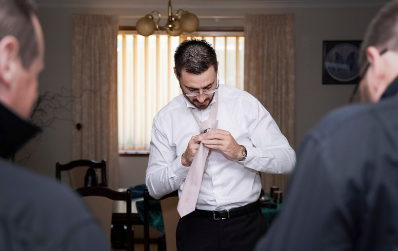 Putting on tie