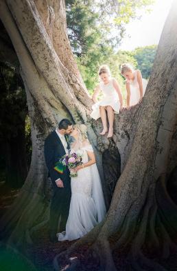 Flower girls climbing a tree