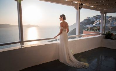Bride looking out over Santorini's Caldera