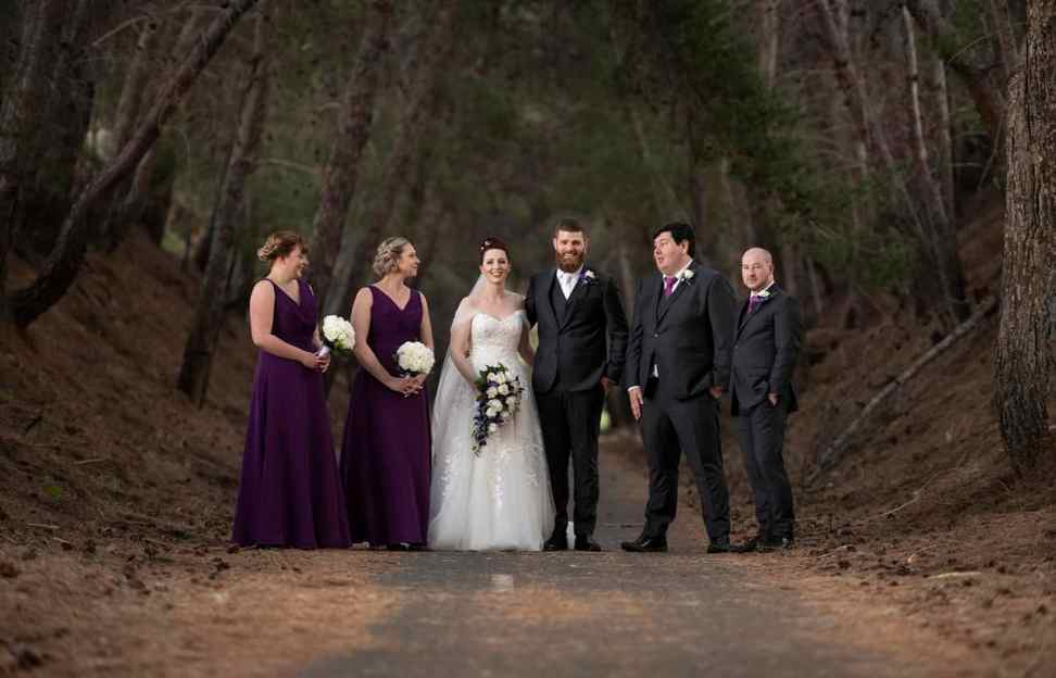 bridal party amongst trees