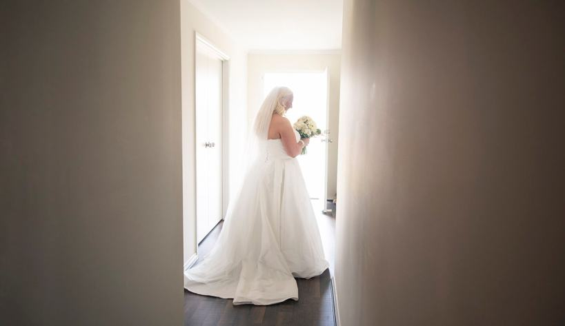 Bride looking pretty walking out door