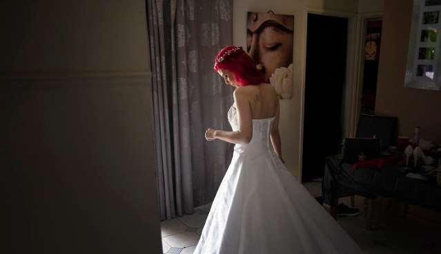 Bride standing in the light