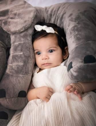 Baby in elephant legs