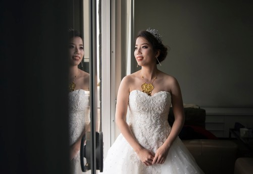 bride looking out windows