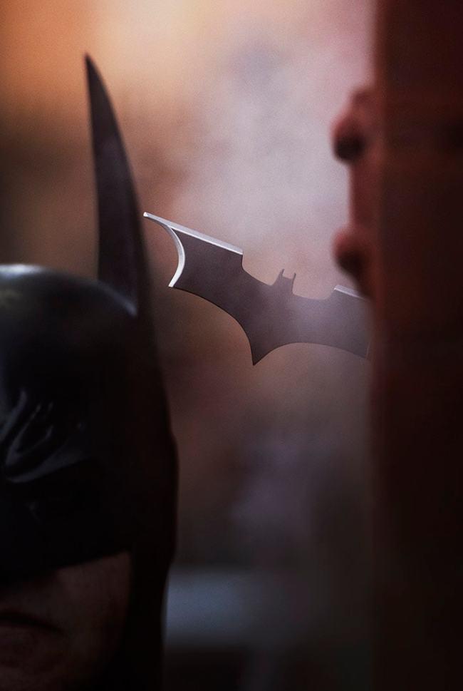 Batman retrieving his batarang