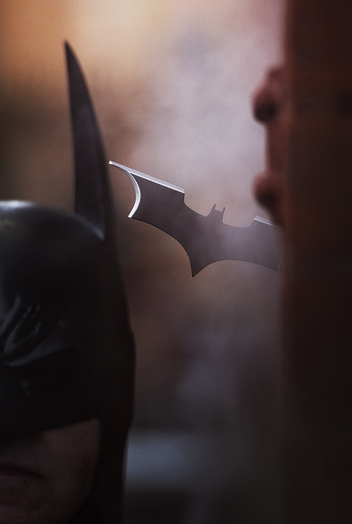 Batman retrieving his batarang