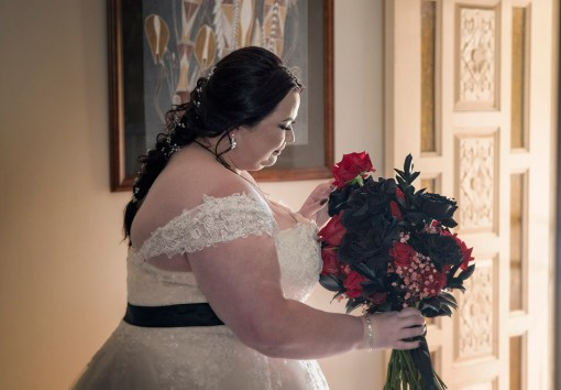 Bride playing with flowers