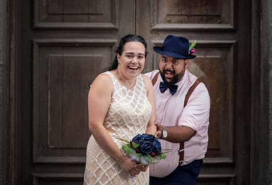 Bride and groom having fun in a doorway