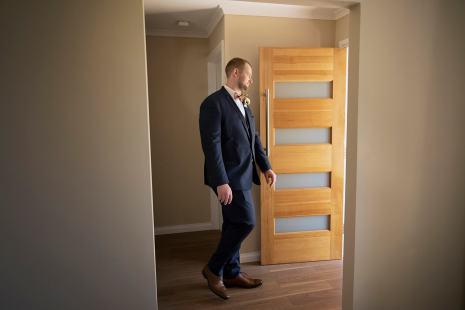 Groom walking out door