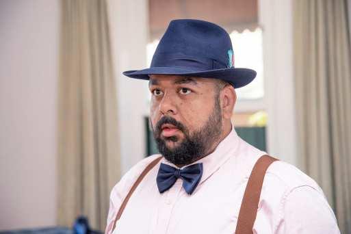 Groom wearing a hat