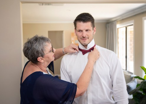 Mum adjusting ties
