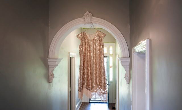 Wedding dress hanging in hallway