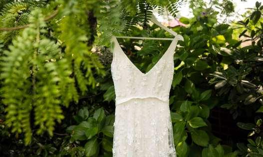 wedding dress hanging in tree