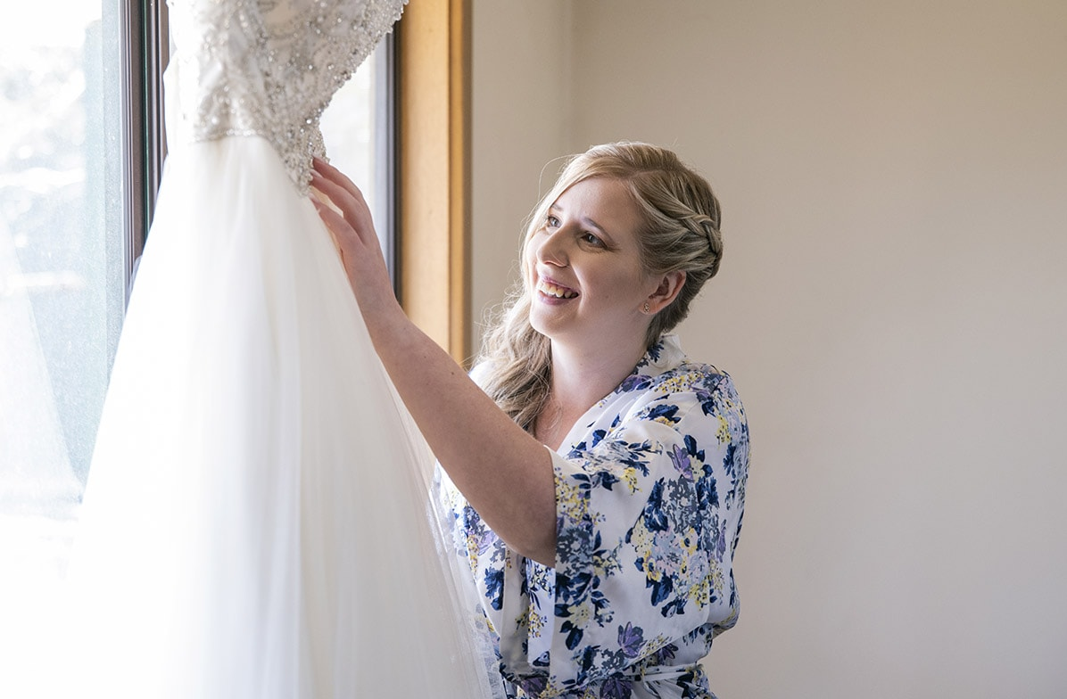 Bride hanging her dress
