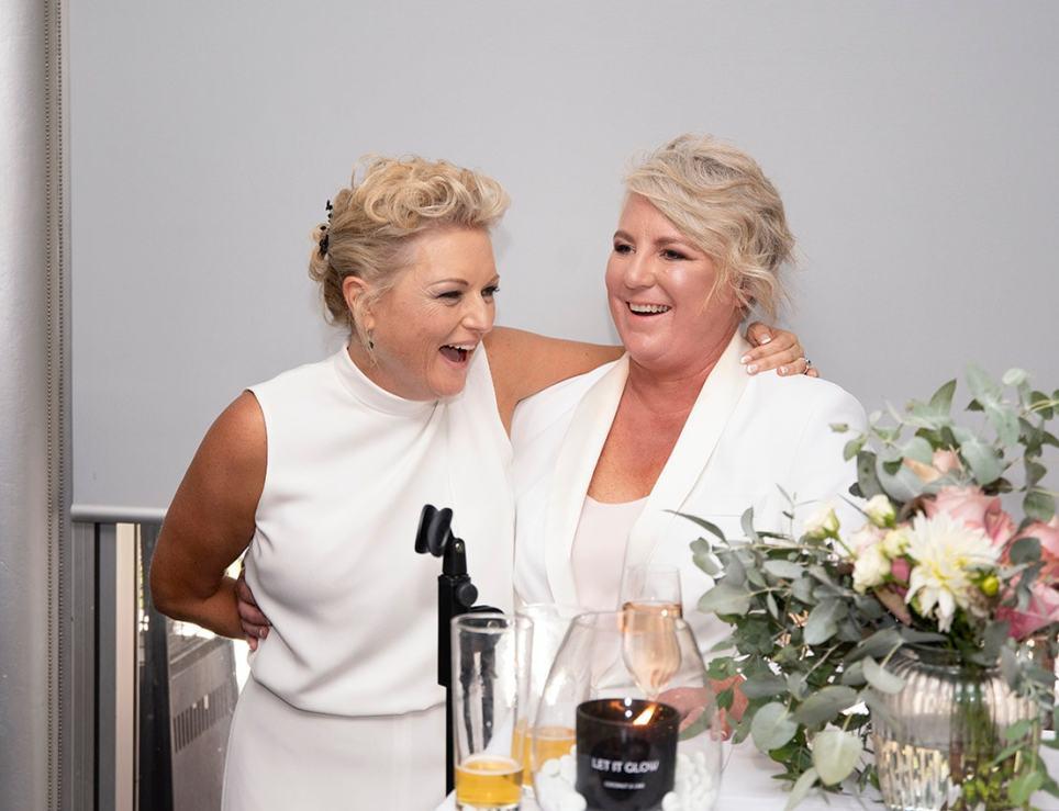 Brides sharing a laugh