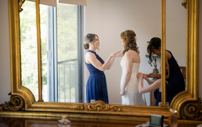 bridal party in mirror