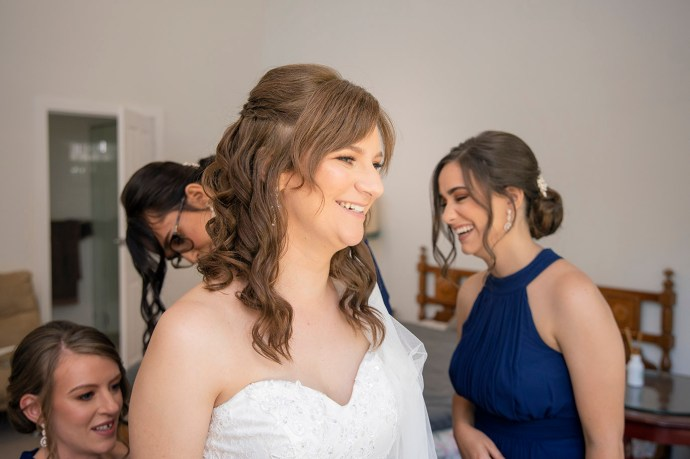 bride getting ready smiling