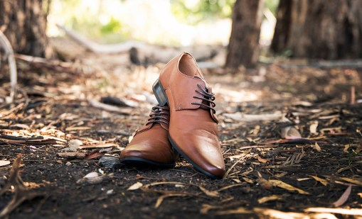 Grooms shoes in woods