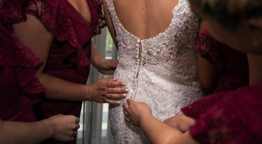 lacing up the wedding dress