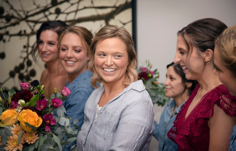 smiling bride with bridal party