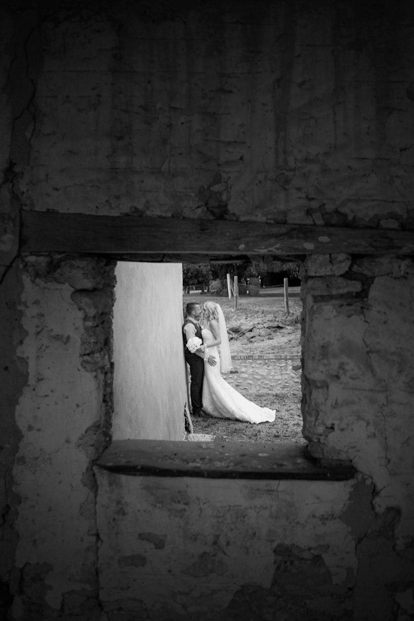 Bride and groom through the window at Paxton Winery