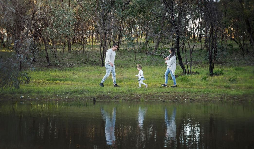 Family walking along the pond