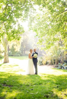 Sun shinging through the leaves on the bridal couple