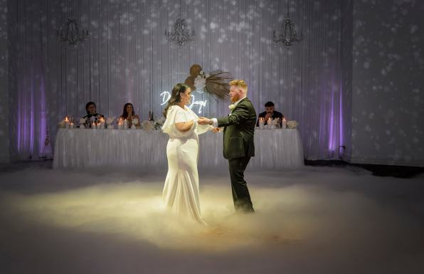 Bride and groom dancing on dry ice