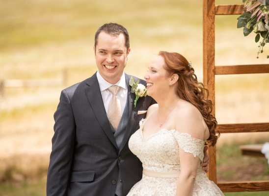 Bridal couple laughing during ceremony at Ivybrook farm