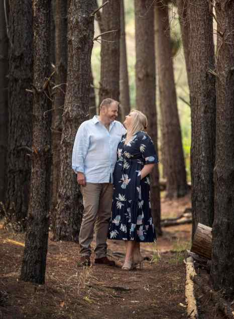 Couple standing amongst the trees in Bone Gully Forest