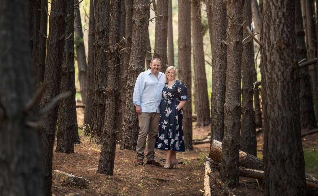 Couple standing amongst the trees in Bone Gully