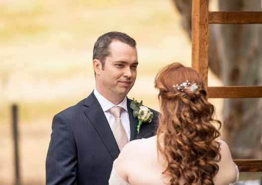 groom smiling at his bride at Ivybrook Farm