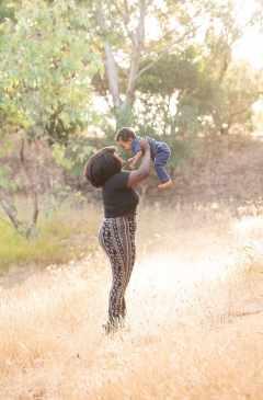 Mum lifting baby up