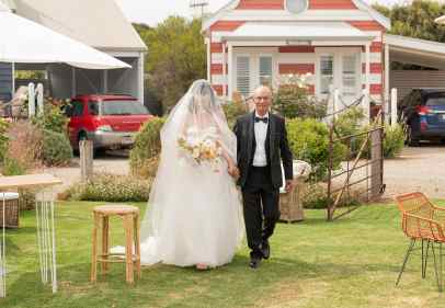 bridal arrival at the beach huts middleton