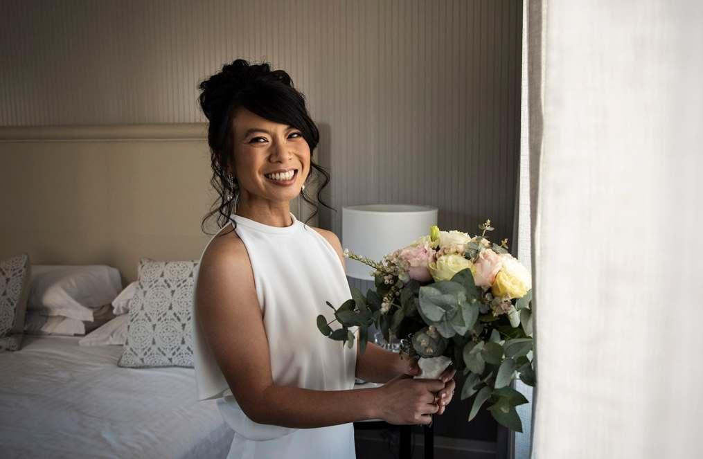bride holding bouquet smiling