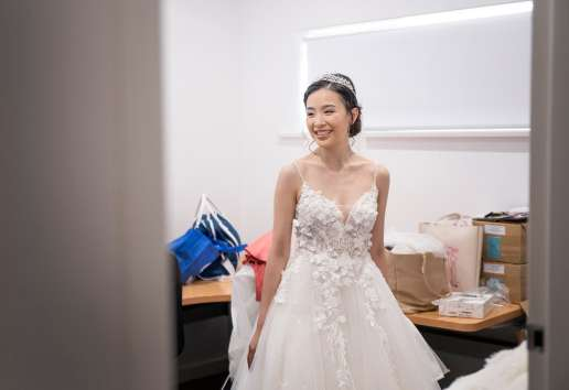 Smiling bride in small room