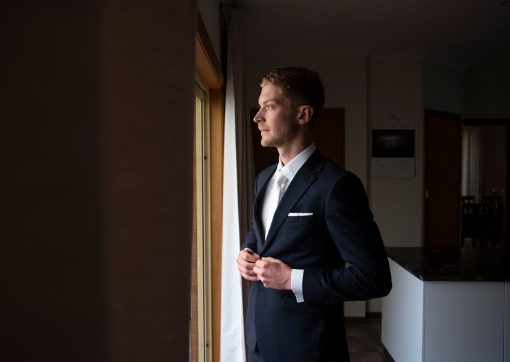 Groom staring out window