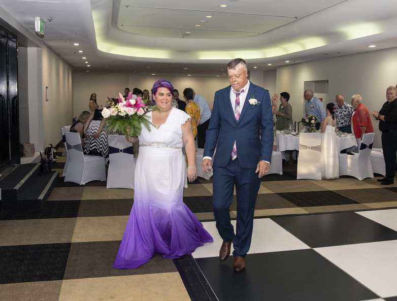 bride and groom arriving at their reception