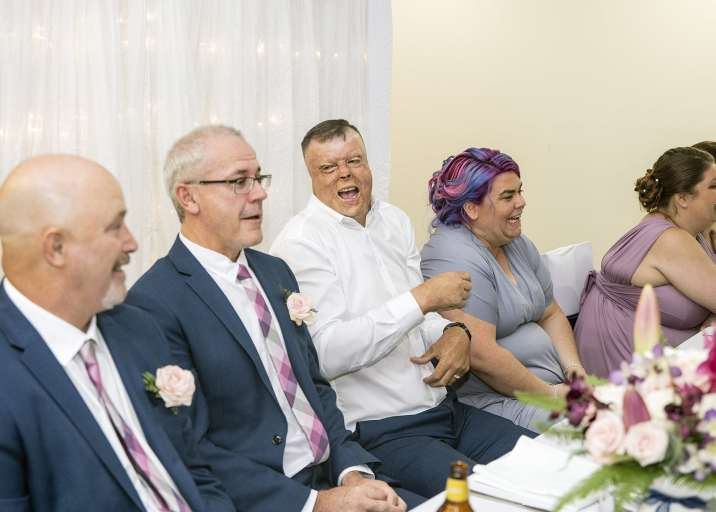 Laughing groom during speeches