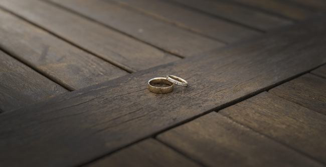 Wedding rings on wooden table