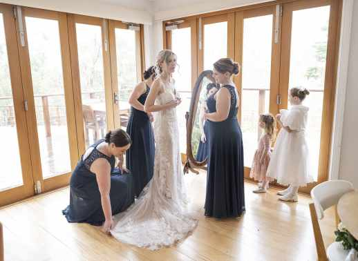 bridal party fussing over bride