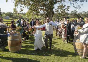 Bride and groom exit from their Quince Brook wedding ceremony