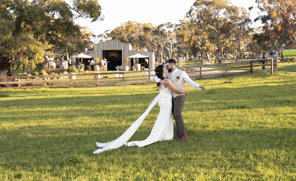 Bride and groom in front of the Quince Brook wedding venue