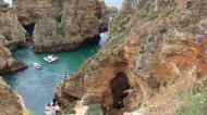 Caves over the ocean, called grottos, are a big tourist attraction in Lagos. Native residents take tourists on a boat ride through the grottos for a small fee.