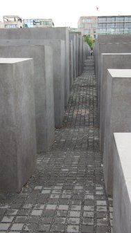 With no sign to explain or announce this Holocaust memorial, tourists often mistake the smaller cement blocks for benches. The artist intended for people to question the meaning of the architecture and make their own interpretation.