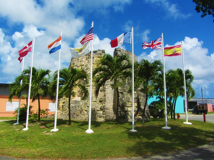 Flags at the entrance to Crusan Rum factory
