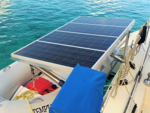 Old solar panels over dinghy